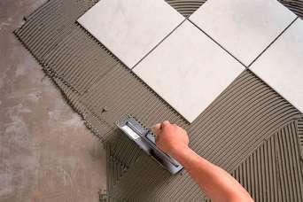 Какой должна быть толщина слоя плиточного клея