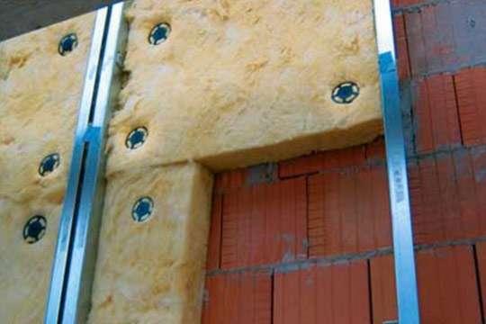 Отделка фасада камнем с утеплителем
